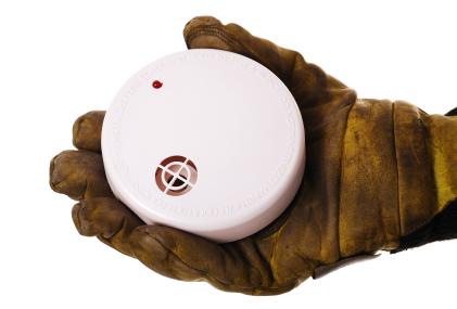 fireman holding smoke detector